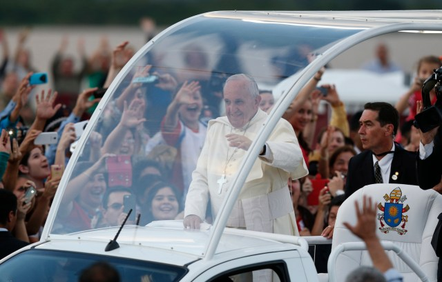 Pope Francis waves to the crowd during his visit to Asuncion, Paraguay, July 12. (CNS/Paul Haring)