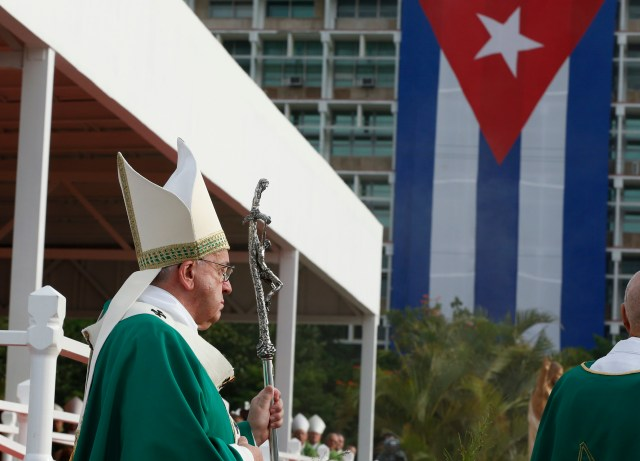 Cuba's flag is seen as Pope Francis arrives in procession to celebrate Mass in Revolution Square in Havana Sept. 20. (CNS/Paul Haring)