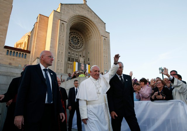 Pope Francis waves as he leaves the Basilica of the National Shrine of the Immaculate Conception after celebrating Mass and the canonization of Junipero Serra Sept. 23 in Washington. (CNS/Paul Haring)