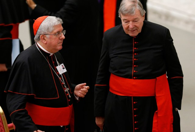 Cardinal Thomas Collins of Toronto and Australian Cardinal George Pell, prefect of the Vatican Secretariat for the Economy, talk after an event marking the 50th anniversary of the Synod of Bishops in Paul VI hall at the Vatican Oct. 17. (CNS/Paul Haring)