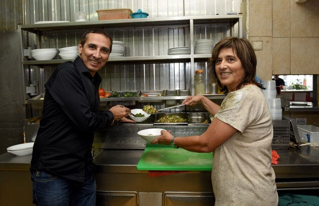 Tony Mattar, a Palestinian Maronite Catholic, and Orly Nir, an Israeli Jew, stand in the kitchen of their co-owned Maxim restaurant in Haifa (CNS/Debbie Hill)