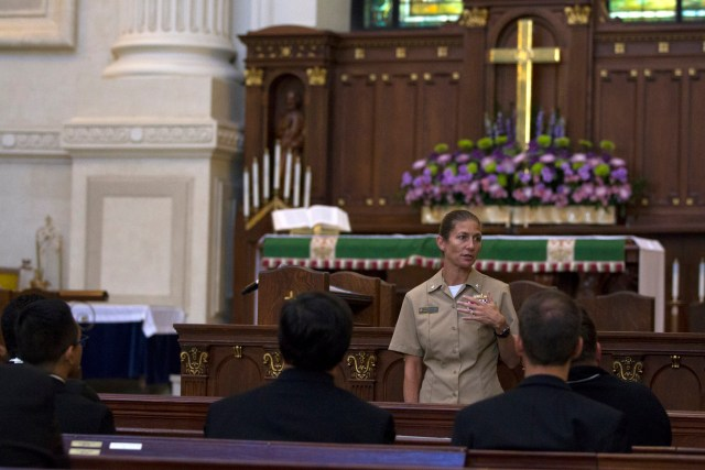 Navy Cmdr. Tracie Severson at the U.S. Naval Academy in Annapolis, Md., tells a group of priests Oct. 6 how military chaplains have impacted her life. Ten priests took part in an early October chaplain recruiting seminar week in Washington held by the Archdiocese for the Military Services. (CNS photo/Chaz Muth)