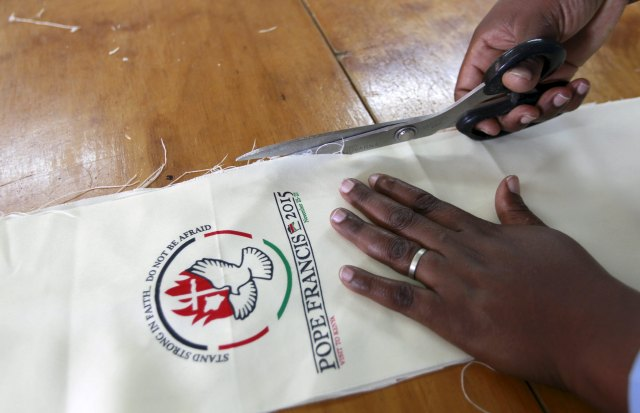 A tailor in Kangemi, outside Nairobi, works on a vestment to be used by Pope Francis during his late-November trip to the country. (CNS/Reuters)