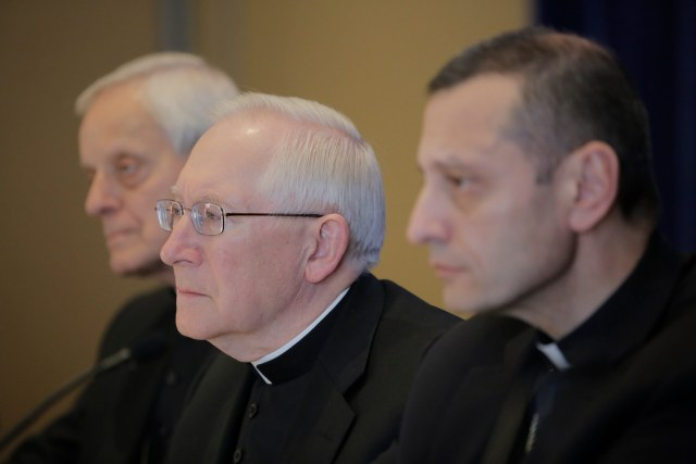Washington Cardinal Donald W. Wuerl, Archbishop Leonard P. Blair of Hartford, Conn., and Bishop Frank J. Caggiano of Bridgeport, Conn., listen to a reporter's question during a news conference Nov. 17 at the 2015 fall general assembly of the U.S. Conference of Catholic Bishops in Baltimore. (CNS/Bob Roller)