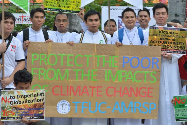 Seminarians join climate justice activists at a plaza in Manila, Philippines, Nov. 29, the day before the start of the U.N. climate change conference, known as the COP21 summit, in Paris. (CNS photo/Simone Orendain)
