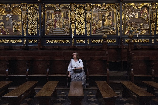 A woman seated in the choir observes the interior of St. Mary's Basilica in Krakow Sept. 3. The city, once the royal capital of Poland, will host the international World Youth Day in July. (CNS photo/Nancy Wiechec)