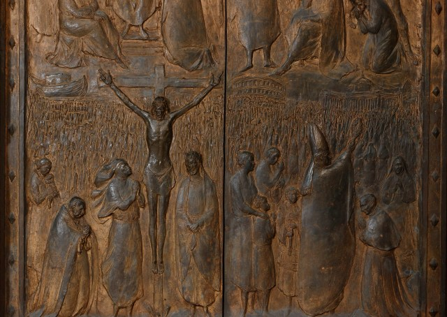Religious artwork decorates the Holy Door at the Basilica of St. Paul Outside the Walls Nov. 19. The Holy Doors of Rome's four papal basilicas will be opened during the Holy Year of Mercy, which begins Dec. 8. (CNS photo/Paul Haring)