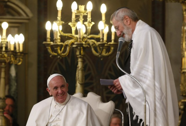 Pope Francis listens as Rabbi Riccardo Di Segni, the chief rabbi of Rome, speaks during during the pope's visit to the main synagogue in Rome Jan. 17. (CNS/Paul Haring)