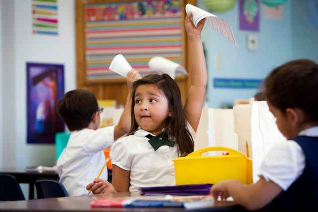 First-grader Kiana Romero finishes an assignment during class at St. Ambrose Catholic School, a Notre Dame ACE Academy in Tucson, Ariz. (CNS/Nancy Wiechec)