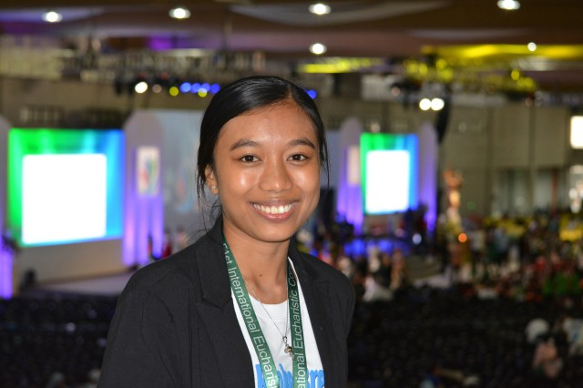 """Former garbage scavenger turned mentor to street children Maria Georgia """"Maggie"""" Cogtas at the 51st International Eucharistic Congress. She moved many in the audience of more than 12,000 to tears when she told of a childhood without playing, only tough work as a garbage picker at dumpsites, construction sites and on the streets. (CNS/Simone Orendain)"""