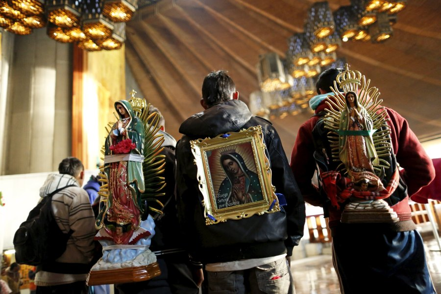 Pilgrims carrying images of the Our Lady of Guadalupe on their backs arrive Feb. 11 at the basilica in her name in Mexico City. Pope Francis will celebrate Mass at the famed basilica Feb. 13. (CNS/Reuters)