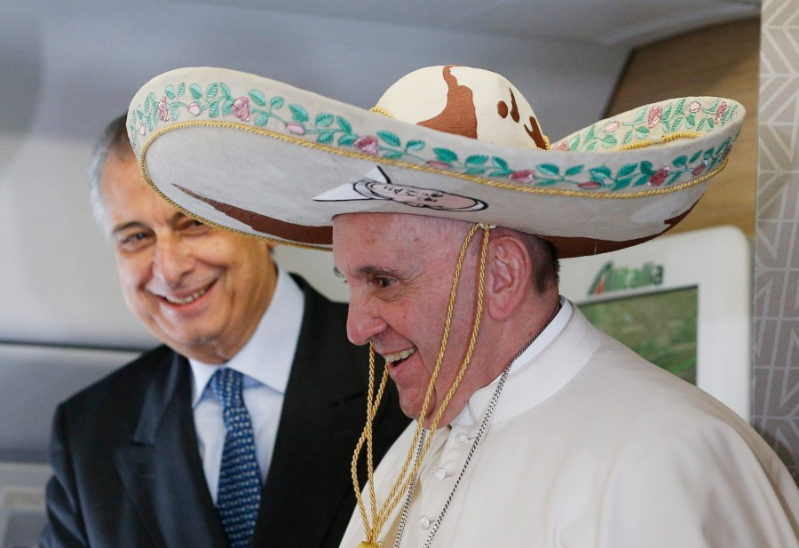 Pope Francis tries on a sombrero while meeting journalists aboard his flight to Havana Feb. 12. Traveling to Mexico for a six-day visit, the pope is stopping briefly in Cuba to meet with Russian Orthodox Patriarch Kirill of Moscow at the Havana airport. (CNS/Paul Haring)