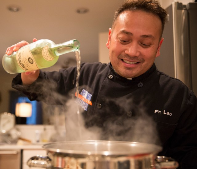 Celebrity chef Father Leo Patalinghug demonstrates how to cook a Lenten seafood pasta meal. (CNS/Chaz Muth)