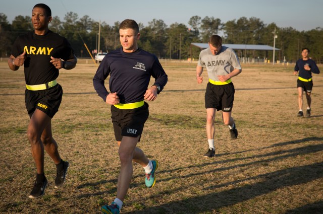 Father Lukasz J. Willenberg, left center, runs with soldiers during morning physical training at Fort Bragg, N.C. Father Willenberg, who holds the rank of captain, is a chaplain at the U.S. Army post and trains as a noncombat paratrooper with the 82nd Airborne Division. (CNS/Chaz Muth)