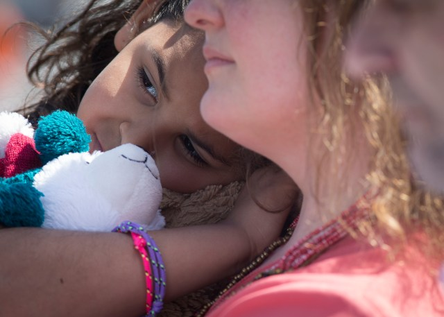 A woman holds a child at a rally in Washington near the White House March 28 to call on the Obama administration to put an end to the detention of immigrant families. (CNS/Tyler Orsburn)