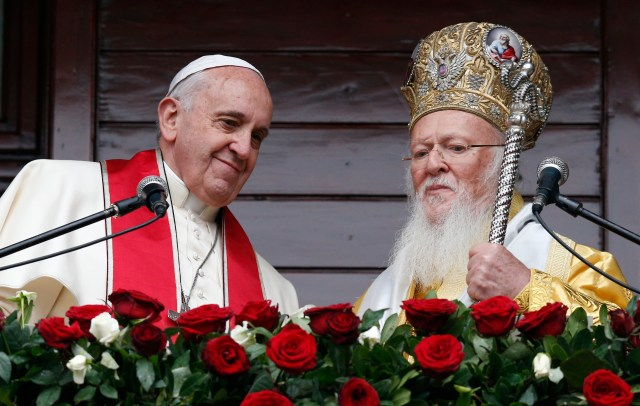Pope Francis and Ecumenical Patriarch Bartholomew of Constantinople after delivering a blessing in Istanbul in 2014. (CNS/Paul Haring)