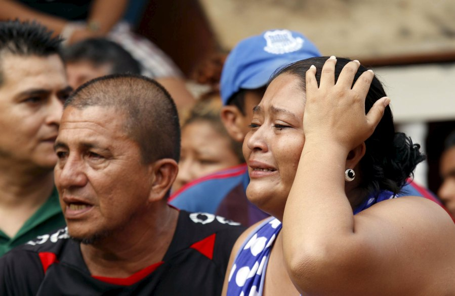 A woman grieves in Manta, Ecuador, April 17 after an earthquake struck off the country's Pacific coast the previous day . Scores were killed or injured and thousands were left homeless in the magnitude-7.8 quake. (CNS/Reuters)