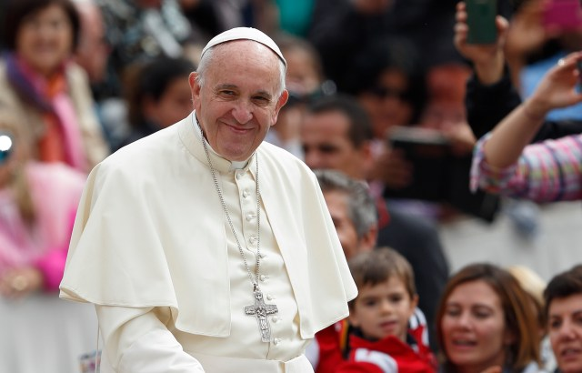 Pope Francis smiles as he arrives to lead his general audience in St. Peter's Square at the Vatican May 11. (CNS/Paul Haring)