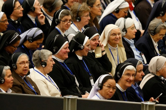 The heads of women's religious orders attend an audience with Pope Francis in Paul VI hall at the Vatican May 12. During a question-and-answer session with members of the International Union of Superiors General, the pope indicated his willingness to establish a commission to study whether women could serve as deacons. (CNS/Paul Haring)