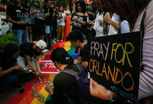 People gather at a June 14 candlelight vigil in Manila, Philippines, in memory of the victims of the mass shooting at a gay nightclub in Orlando, Fla. Philippine Catholic bishops called for vigilance against bullying, ostracism and harassment of gay people in the wake of the incident. (CNS/EPA)