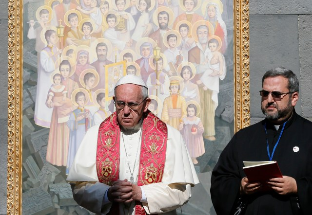 Pope Francis visits the Tsitsernakaberd Memorial in Yerevan, Armenia, June 25. The monument honors the estimated 1.5 million Armenians killed by Ottoman Turks in 1915-18. The icon behind the pope represents those killed. (CNS photo/Paul Haring)