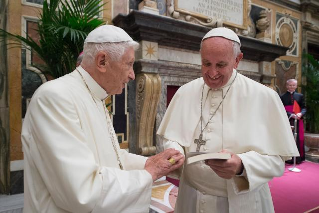 Pope Francis greets retired Pope Benedict XVI during a June 28 ceremony at the Vatican marking the 65th anniversary of the retired pope's priestly ordination. (CNS/L'Osservatore Romano)