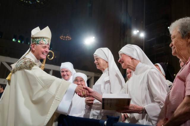 Cardinal Donald W. Wuerl of Washington greets members of the Little Sisters of the Poor July 4 after the closing Mass of the Fortnight for Freedom at the Basilica of the National Shrine of the Immaculate Conception in Washington. (CNS/Jaclyn Lippelmann, Catholic Standard)