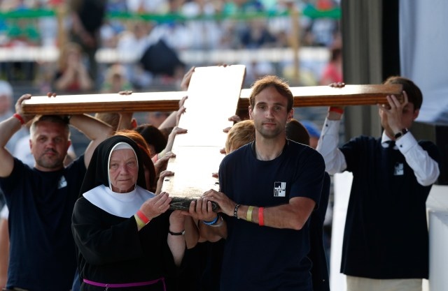 The cross is carried in procession during the Way of the Cross at World Youth Day July 29. (CNS/Paul Haring)