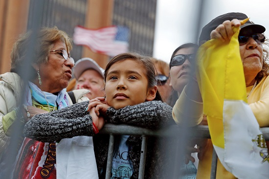 People watch on large screens during as Pope Francis celebrates Mass in Philadelphia Sept. 26. World Youth Day organizers say the changing demographics of the church in the United States will be reflected in the pilgrims to World Youth Day in Krakow. (CNS photo/Jonathan Ernst, Reuters)