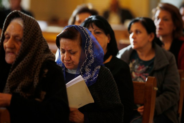 Iraqi Christians attend Mass at a church in Baghdad last year. (CNS/Reuters)