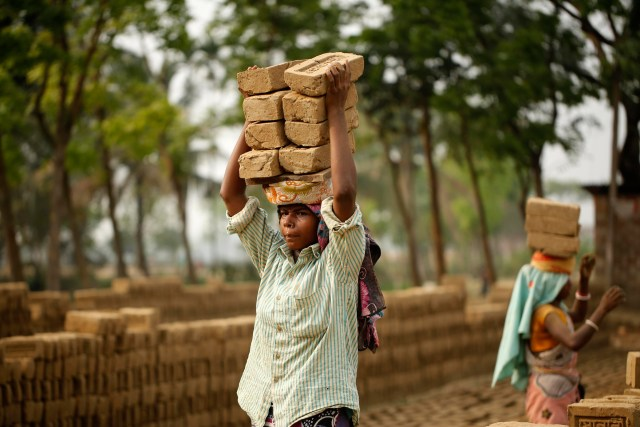 Women carry bricks on their heads in Habigonj, Bangladesh, March 25, 2015. Pope Francis prayed for all exploited women and girls during the feast of the Assumption at the Vatican Aug. 15. (CNS photo/Abir Abdullah, EPA)