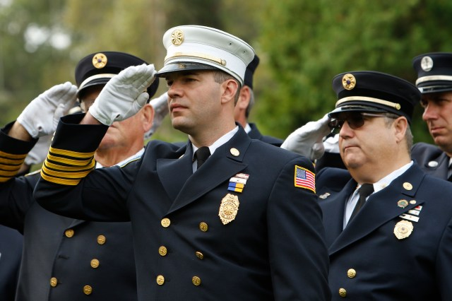 Firefighters salute during a memorial service Sept. 11 in Hauppauge, N.Y., marking the 15th anniversary of the 9/11 terrorist attacks that claimed the lives of nearly 3,000 people in New York City, Shanksville, Pa., and at the Pentagon. (CNS/Gregory A. Shemitz)