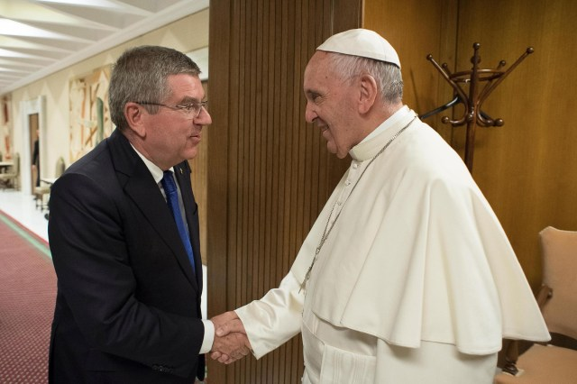Thomas Bach, president of the International Olympic Committee, greets Pope Francis during their meeting ahead of the opening ceremony of first global conference of faith and sport at the Vatican Oct. 5. (CNS/L'Osservatore via EPA)