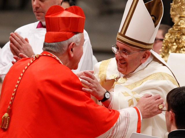 Pope Francis embraces new Cardinal Vincent Nichols of Westminster, England, during a consistory in St. Peter's Basilica in 2014. (CNS Paul Haring)