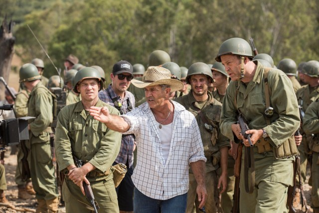 """Director Mel Gibson, center, on the set of """"Hacksaw Ridge."""" (CNS/Lionsgate)"""