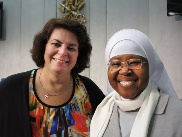 Ivonne van de Kar, an anti-trafficking advocate from the Netherlands, is seen at the Vatican press hall with Sister Monica Chikwe, a member of the Hospitaler Sisters of Mercy, who works with trafficked Nigerian women. They are both members of the RENATE network of religious congregations in Europe fighting human trafficking. (CNS/Carol Glatz)