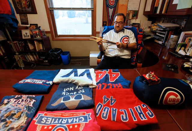 Father Michael Novick, pastor of St. Lawrence O'Toole in Matteson, Ill., shows off his Cubs gear. (CNS/Karen Callaway, Catholic New World)