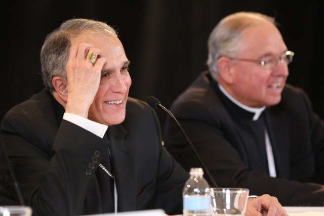 Cardinal Daniel N. DiNardo of Galveston-Houston addresses a news conference Nov. 15 at the fall general assembly of the U.S. Conference of Catholic Bishops in Baltimore. The cardinal was elected USCCB president that morning. Seated to his left is Archbishop Jose H. Gomez of Los Angeles, who was elected USCCB vice president. (CNS/Bob Roller)