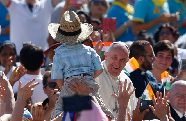 Pope Francis waves to a boy in St. Peter's Square Sept. 3. (CNS/Paul Haring)
