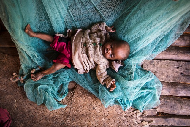 An eight-month-old baby lies on the floor at home in Amboasary, Madagascar, in 2015. Hunger levels are now severe in drought-ridden southern Madagascar. (CNS/EPA)