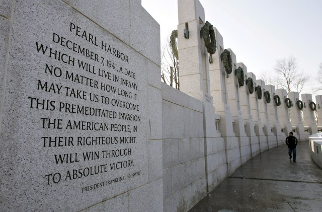 A visitor to the National World War II Memorial in Washington walks near a quote from President Franklin D. Roosevelt on Pearl Harbor Remembrance Day in 2015. Dec. 7 marks the 75th anniversary of the attack. (CNS/Matthew Cavanaugh, EPA)