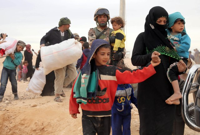 Syrian refugees arrive in early May at a camp on the border in Royashed, Jordan. (CNS/EPA)