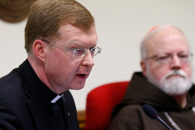Jesuit Father Hans Zollner speaks in early February during a news conference officially launching the Center for Child Protection in Rome. At right is Cardinal Sean P. O'Malley of Boston, who heads the Pontifical Commission for Child Protection. (CNS/Paul Haring)
