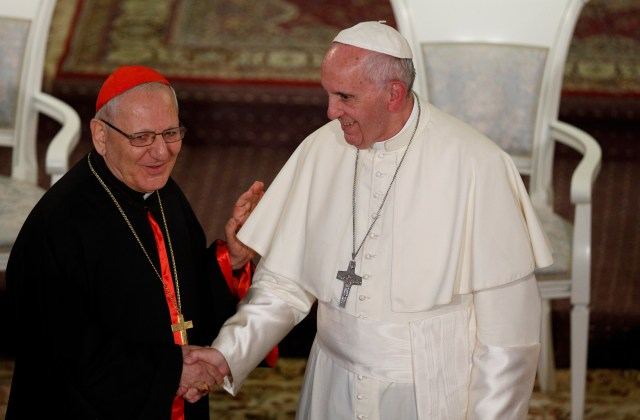 Pope Francis greets Chaldean Catholic Patriarch Louis Sako of Baghdad during a meeting with Chaldean Catholics at the Church of St. Simon the Tanner in Tbilisi, Georgia, Sept. 30. (CNS/Paul Haring)