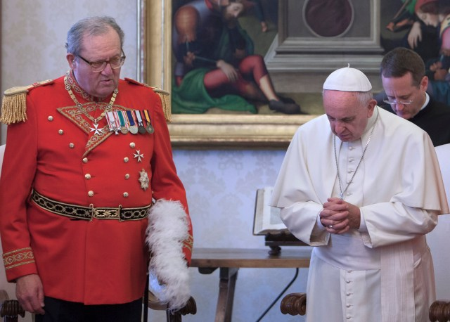Pope Francis is pictured with Fra Matthew Festing, grand master of the Sovereign Military Order of Malta, during a private audience with members of the order at the Vatican in this June 23, 2016, file photo. (CNS/pool photo)