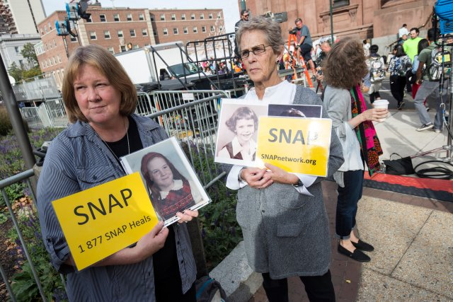 Becky Ianni of Burke, Va., and Barbara Dorris of St. Louis, both members of the Survivors Network of those Abused by Priests demonstrate at the Cathedral Basilica of SS. Peter and Paul in Philadelphia in 2015 during #PopeFrancis' visit to the United States. The pope met privately with a group of survivors of sexual abuse in Philadelphia. (CNS/Joshua Roberts)