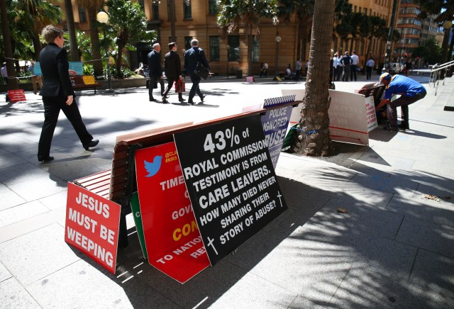 A display of protest placards sit outside the Royal Commission into Child Sex Abuse Feb. 23 in Sydney. (CNS/EPA)