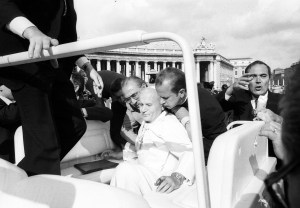 Pope John Paul II is assisted by aides after being shot in St. Peter's Square May 13, 1981. He was greeting pilgrims on the feast of Our Lady of Fatima. (CNS/L'Osservatore Romano)