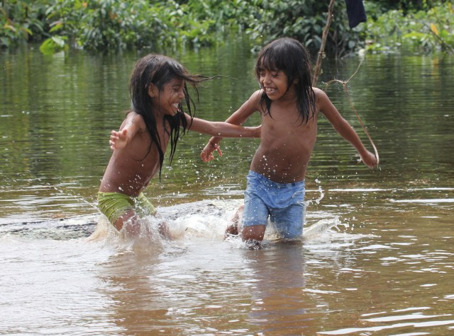 Urarina children play in the Urituyacu River that flows past their village in the Peruvian Amazon, in this 2014 photo. (CNS file/Barbara Fraser)