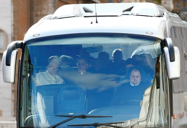 Pope Francis is seen inside a bus at the Vatican heading to Ariccia, south of Rome, to make his Lenten spiritual exercises March 5. The pope and top members of the Roman Curia are on retreat March 5-10. (CNS/Reuters)
